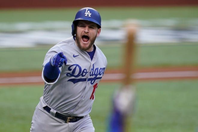 Dodgers' Max Muncy celebrates after hitting a grand slam home run against the Atlanta Braves during the first inning of Game 3 of the National League Championship Series on Wednesday, Oct. 14, 2020, in Arlington, Texas.