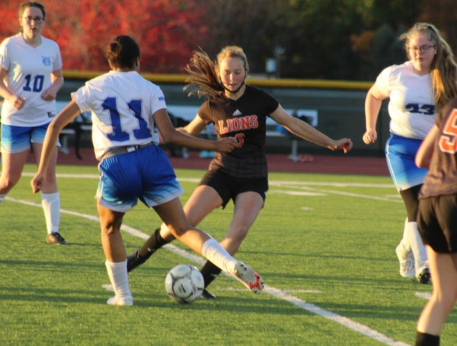 Wellsville's Sawyer Burke (3) and Hinsdale's Ava Belec both eye a kick Tuesday night in Wellsville.