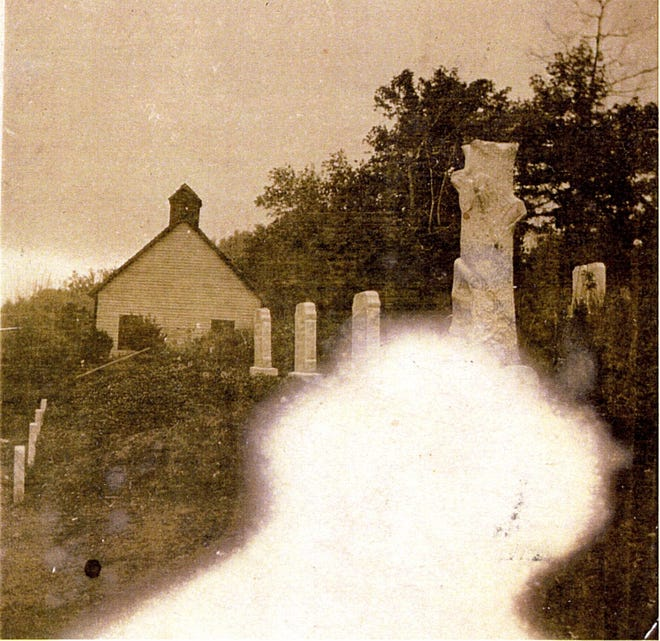 A Swannanoa Valley ghost drifted into this circa 1895 photograph of the old North Fork School and cemetery.