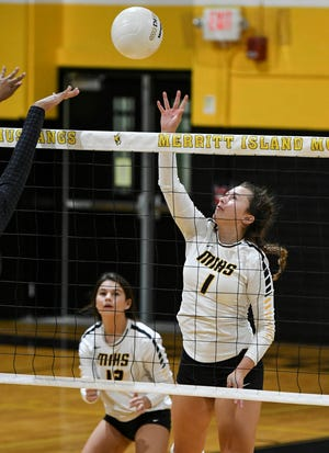 Macy Reynolds of Merritt Island taps the ball over the net during Tuesday's match against Rockledge. Craig Bailey/FLORIDA TODAY via USA TODAY NETWORK