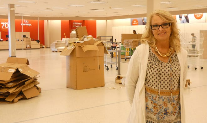 Kim Keller will be the manager of the new Burkes Outlet in the East Pointe Shopping Center. On Tuesday, workers were busy installing fixtures in the store, which is scheduled to open on Nov. 2.