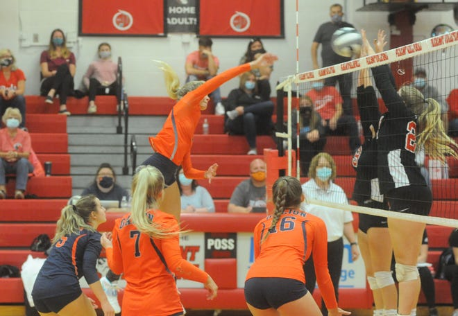 Galion's Samantha Comer smashes a ball through Pleasant's Lauren Gierhart and Kennedy Colby.