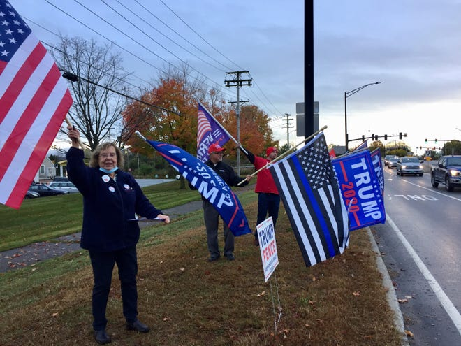 "Supporters of President Donald Trump's reelection campaign line Vermont 15 with Trump flags, as well as an American flag and a ""Thin Blue Line"" flag, on Oct. 13, 2020."