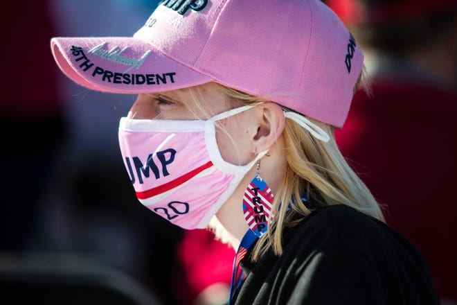 upporter Justina Movall of Mount Pleasant waits for the arrival of President Donald Trump before a Make America Great Again Rally Wednesday outside the Des Moines International Airport.