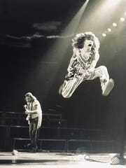 David Bertinelli took this photo of rock star Eddie Van Halen's brother-in-law mid-flight during a performance in Dallas, Texas in 1982.