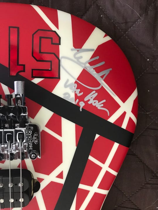 Probably one of the last guitars that Eddie Van Halen would have signed. This is the EVH Striped Series 5150 guitar that he autographed and donated to St. Mary School in Charlevoix to raise money for the school in February.