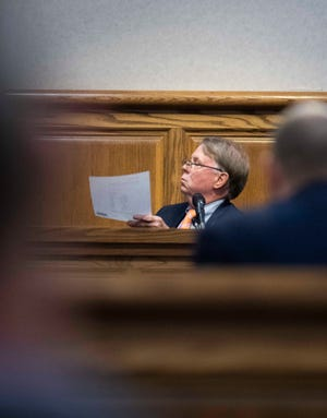 Madison County Sheriff John Mehr is cross-examined by his attorney Lawrence Laurenzi the second day of lawsuit trial against the county commission at Madison County Circuit Court in Jackson, Tenn., Wednesday, Oct. 14, 2020.