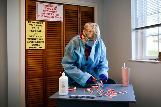 """Election official Maxine Shirk puts out """"I voted"""" stickers at  Meridian Baptist Church in South Knoxville on Wednesday, October 14, 2020, the first day of early voting."""