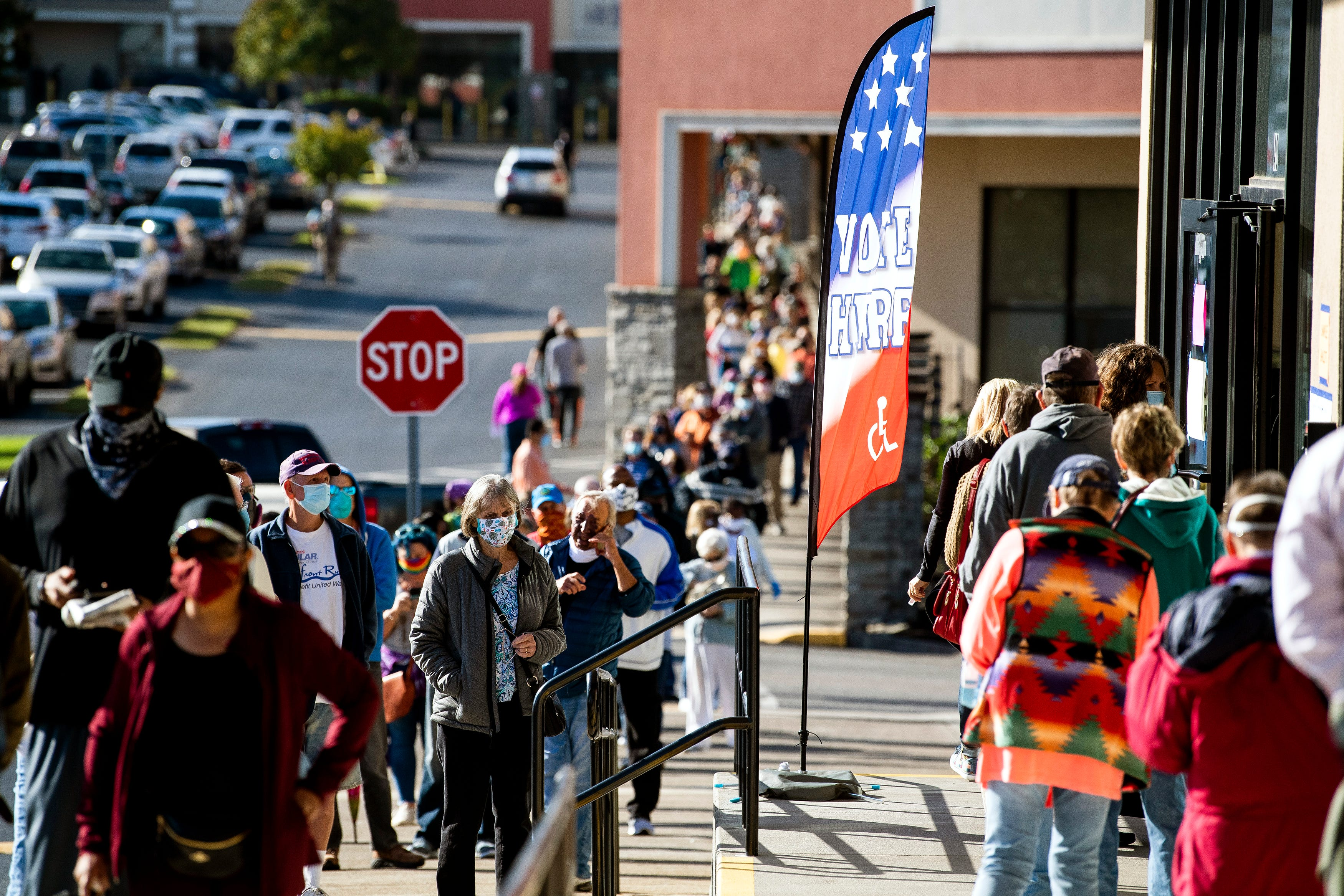 Voters wait in line to vote at the Downtown West early voting location in Knoxville, Tenn., on the first day of early voting in Tennessee on Wednesday, Oct. 14, 2020.