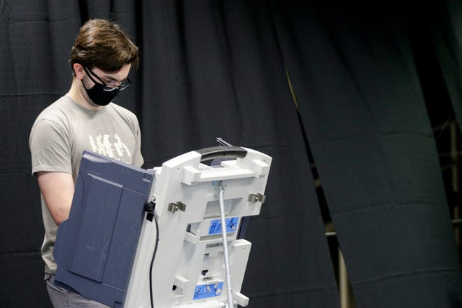 Sam Westendorf, a junior biology student at Purdue University, votes ahead of the 2020 general election at Mackey Arena, Wednesday, Oct. 14, 2020 in West Lafayette.