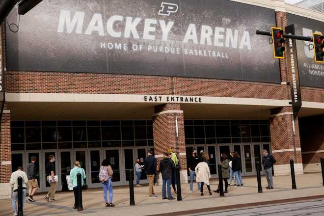 Voters line up outside Mackey Arena for early voting, Wednesday, Oct. 14, 2020 in West Lafayette.