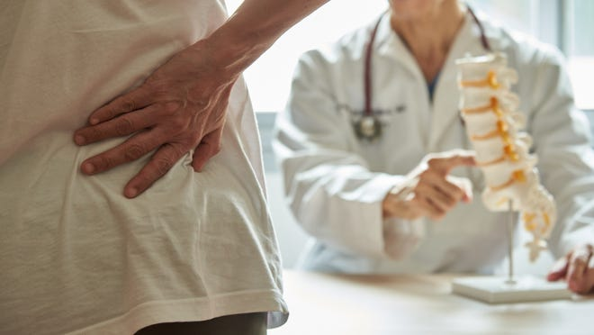 Treatments for back pain at McLaren may include physical therapy and anti-inflammatories.