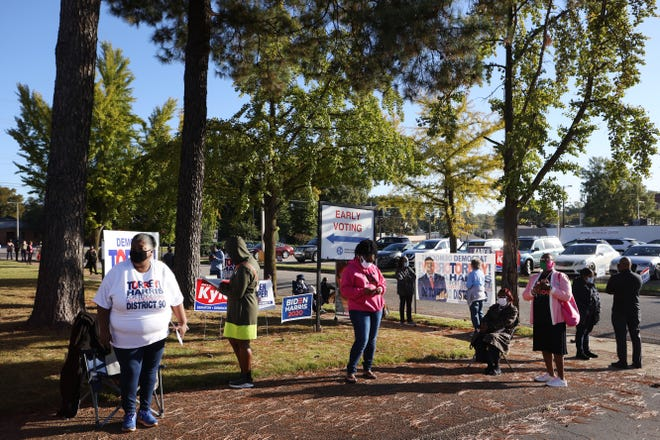 People wait in line to vote at Mississippi Boulevard Christian Church during the first day of early voting in Memphis, Tenn. On Wednesday, Oct 14, 2020.