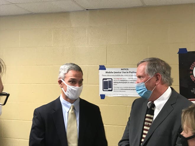 U.S. Department of Homeland Security Acting Deputy Secretary Ken Cuccinelli, left, speaks with Wilson County Administrator of Elections Phillip Warren, right, at the Charlie Daniels Community Center in Mt. Juliet on Wednesday, Oct. 14, 2020.
