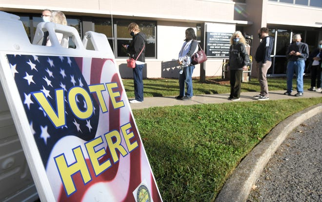 Several hundred voters line up before the polls open at the Williamson County Administrative Complex during the first day of early voting Wednesday, Oct. 14, 2020 in Franklin, Tenn.