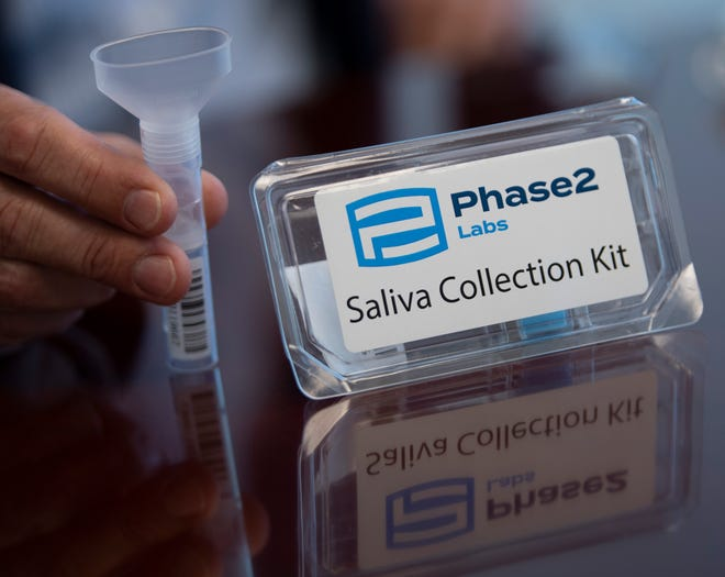 A Phase2 Labs saliva collection kit is demonstrated Wednesday, Oct. 14, 2020 in Nashville, Tenn. The lab is working to implement saliva testing for coronavirus at its facility.