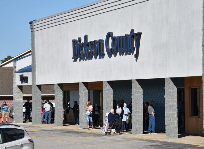 Voters wait in line on the first day of early voting at the Dickson County Public Library in Dickson on Oct. 14.