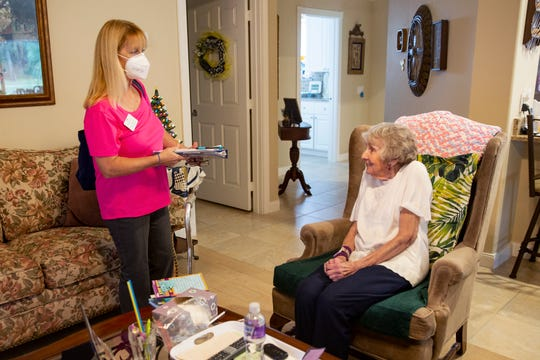 Joanne Freeborn, left, a registered nurse with KcKenney Home Care provides home health services to care for Jean Murphy, Tuesday, Oct. 13, 2020, at Murphy's home in East Naples.