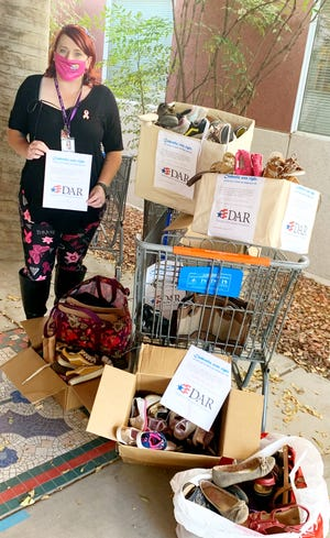 Pamela Strobbe, La Casa event coordinator, pictured with Doña Ana chapter of the National Society of the Daughters of the American Revolution donations.