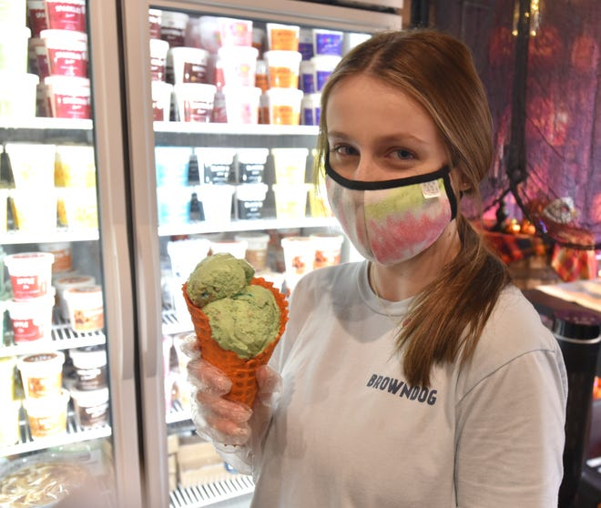 Natalie Carroll with two scoops of Browndog ice cream last fall at the Main Street Northville location. Browndog plans to reopen its shop serving ice cream and other items in downtown Farmington later this year.
