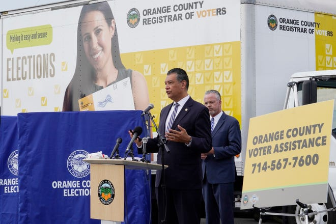FILE - In this Oct. 5, 2020, file photo, California Secretary of State Alex Padilla, left, and Orange County Registrar of Voters Neal Kelley hold a news conference on Orange County's comprehensive plans to safeguard the election and provide transparency in Santa Ana, Calif.