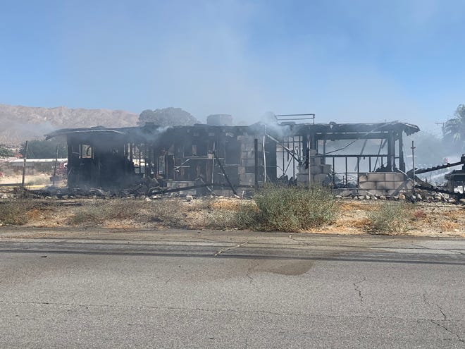 This photo shows a home that was destroyed in a fire at Acoma Avenue and Cholla Drive in Desert Hot Springs Wednesday, Oct. 14, 2020. Investigators say a vacant home was destroyed and the cause of the fire is under investigation.
