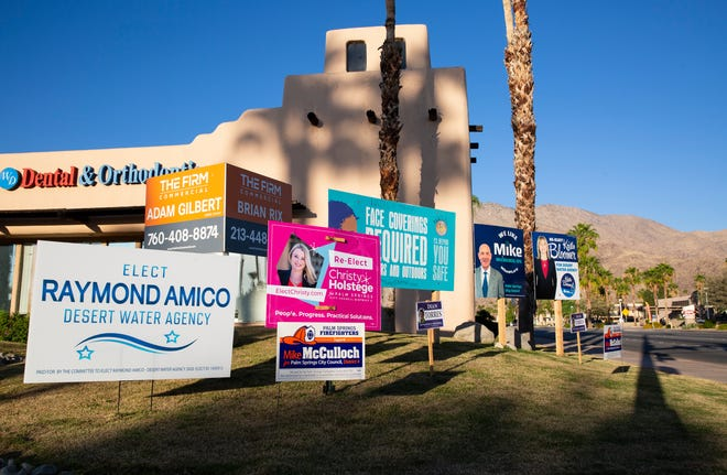 Campaign signs fill a grassy area on the corner of Ramon Road and Sunrise Way in Palm Springs, Calif., on October 14, 2020.