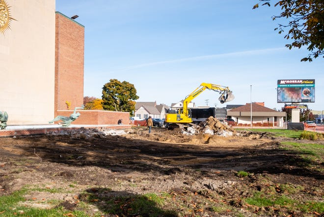 Crews demolish the concrete base and stairs area at McMorran Plaza. Officials said the renovation project, which includes an ice rink, isn't yet underway despite the activity.