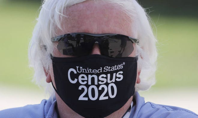 Amid concerns of the spread of COVID-19, census worker Ken Leonard wore a mask as he manned a U.S. Census walk-up counting site set up for Hunt County in Greenville, Texas, July 31.