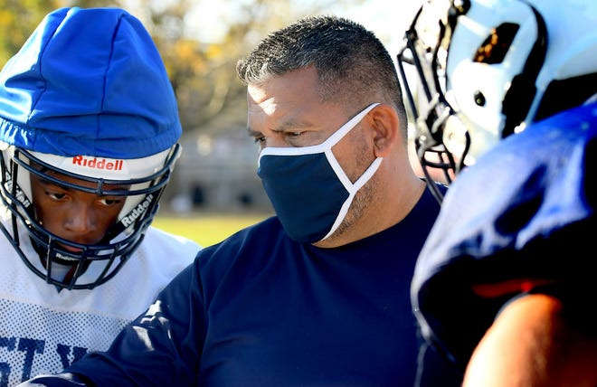 West York head coach Ivan Quinones talks with player Darnell Goring-Pollard at practice at the school Wednesday, Oct. 14, 2020. The 2-0 Bulldogs play a home conference game against Kennard-Dale Friday. Bill Kalina photo