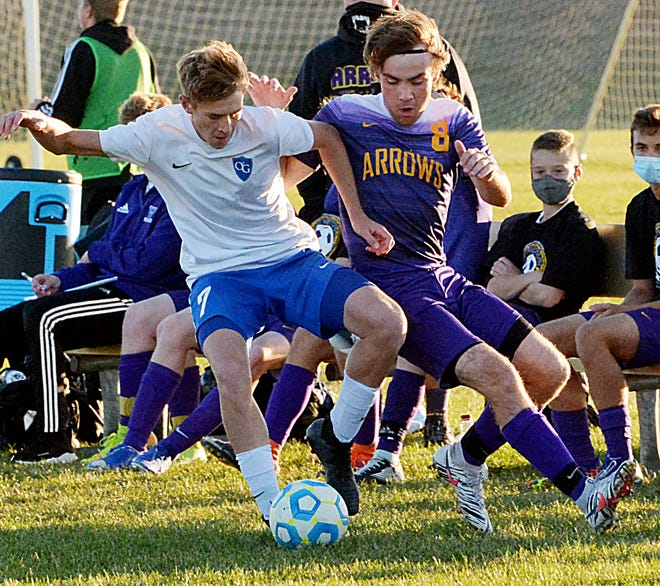 O'Gorman's Gabe Ripperda (left) battles for possession with Watertown's Hunter Mitchell during their semifinal match Tuesday in the state Class AA high school boys soccer playoffs at the ANZA Soccer Complex in Watertown. O'Gorman won 2-1.