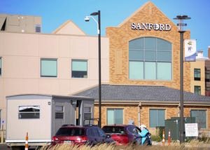 Sanford healthcare workers provide COVID-19 testing on Tuesday, October 13, at the Sanford Fieldhouse in Sioux Falls.