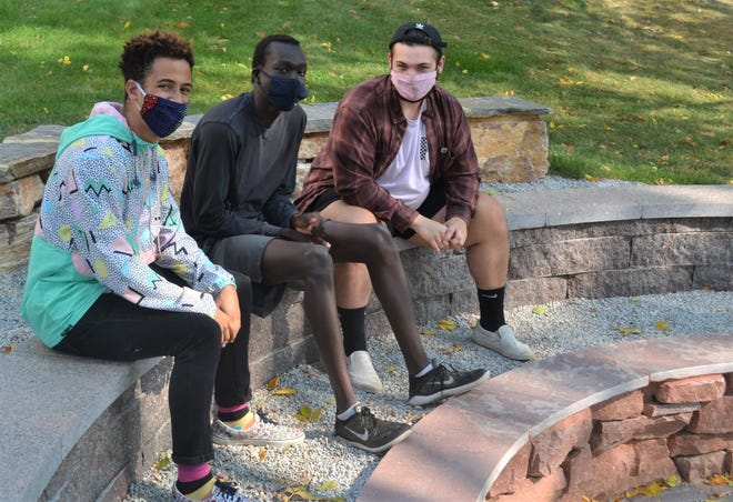 """Self-dubbed """"The Quarantine Boys,"""" Augustana University freshmen Alex Rosauer,  Janyjor Ruei and Rob Waring (left to right) sit together on the Augustana campus after being in quarantine in September. The three friends decided to pass the time writing and composing songs about how they felt during their 14-day period separated from society during the ongoing coronavirus pandemic."""