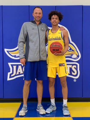 South Dakota State coach Eric Henderson poses with Zeke Mayo during a recruiting visit to Brookings last fall.