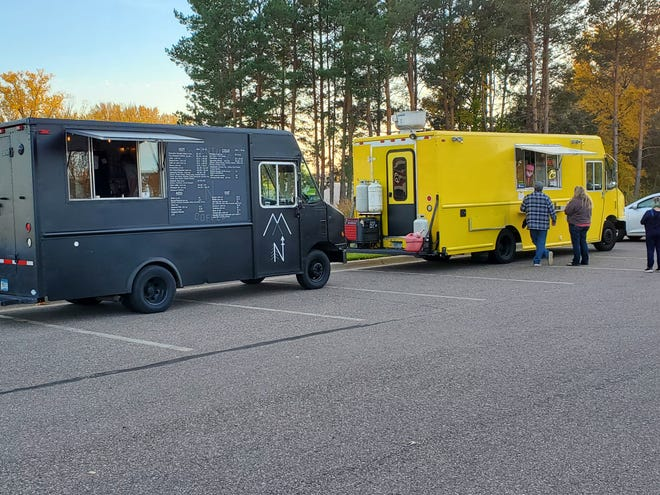 The Adventure Coffee MN and Jimmy Z's Concessions trucks serve food to people gathering to speak to the Sauk Rapids City Council just before 6:00 p.m. Tuesday, Oct. 2020