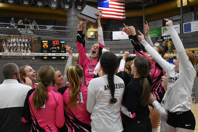 Desert Hills celebrates a second-straight Region 9 volleyball title after beating Dixie 3-1.