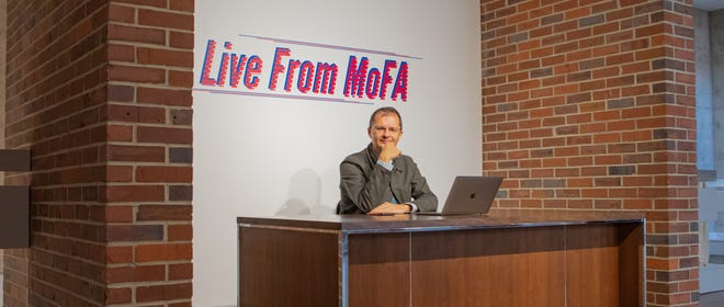 """Preston McLane in the museum's """"Live from MoFA"""" booth, the space they used to host virtual tours, artist talks, and conversations with virtual visitors, students, and project partners."""