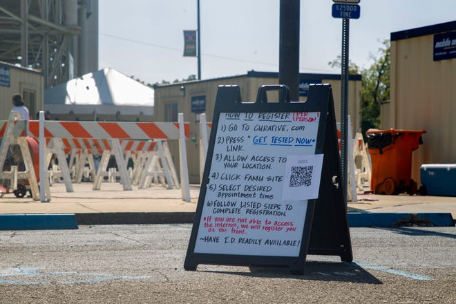 A sign is posted outside the testing site at Bragg Memorial Stadium on how to register for COVID-19 testing.
