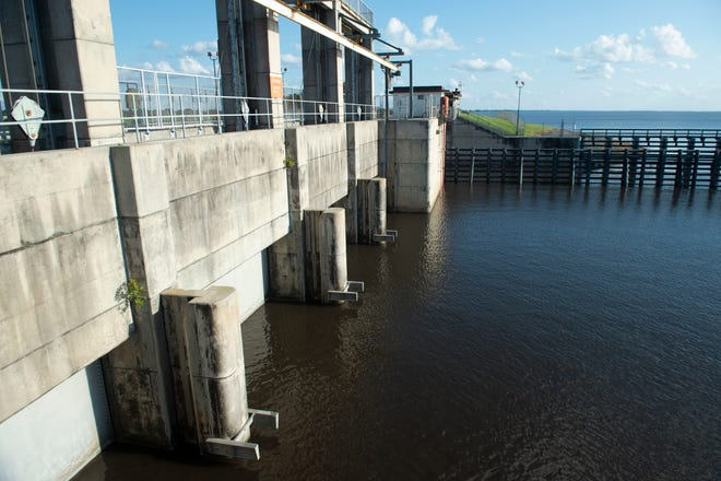 """Lake Okeechobee water begins moving through the Port Mayaca Lock and Dam on Wednesday, Oct. 14, 2020, in Martin County. The St. Lucie River estuary is due to receive about 1.16 billion gallons of lake water a day for """"close to a month,"""" according to Col. Andrew Kelly, the Army Corps of Engineers commander for Florida."""