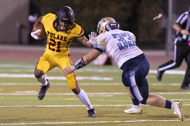 Tulare Union's Xavier Hailey (21) evades Monache's Hunter Weimer in an East Yosemite League football game on Thursday, October 3, 2019.