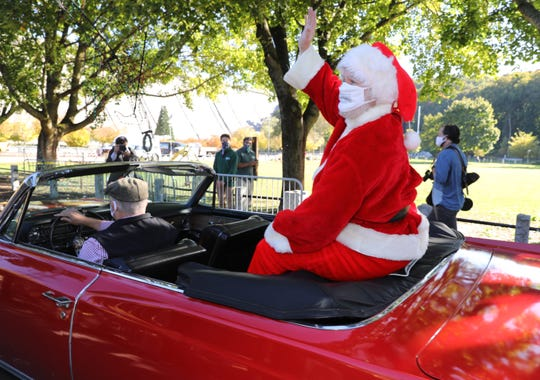 Santa Claus (John Cedric Anderson) arrives in a 1964 Cadillac Eldorado owned by John O'Brien, at Kensico Dam in Valhalla, Oct. 14, 2020. This year's Westchester Winter Wonderland at Kensico Dam will be a Drive-Thru attraction.  The event kicks off Nov. 27, 2020 and runs through Jan. 3, 2021.