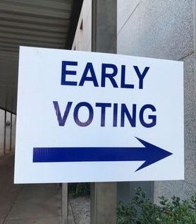 This sign directed voters to the entrance for early voting for the Nov. 3 General Election at the Wichita County Courthouse Oct. 14, 2020.