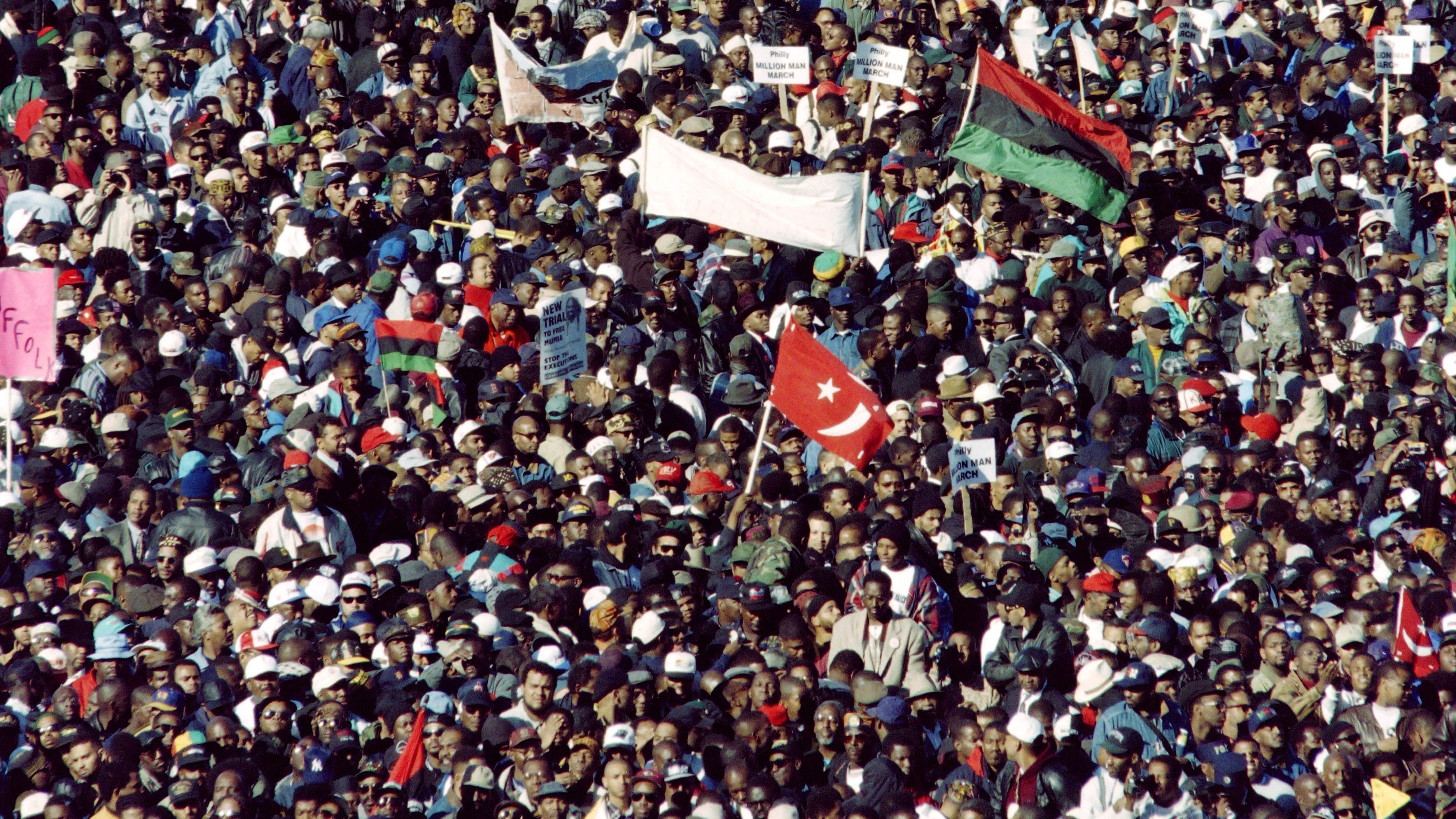Tens of thousands of people gathered on the National Mall, seen here from the U.S. Capitol Building, for the Million Man March on Oct. 16, 1995. The march, called by Nation of Islam leader Louis Farrakhan, was intended as a day for Black men to unite and pledge self-reliance and commitment to their families and communities.