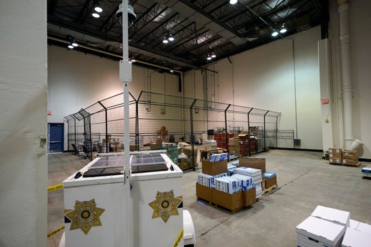 A security camera is positioned to monitor a cage where mail-in ballots will be stored after arriving at the Harris County election headquarters on Sept. 29, 2020, in Houston, Texas.
