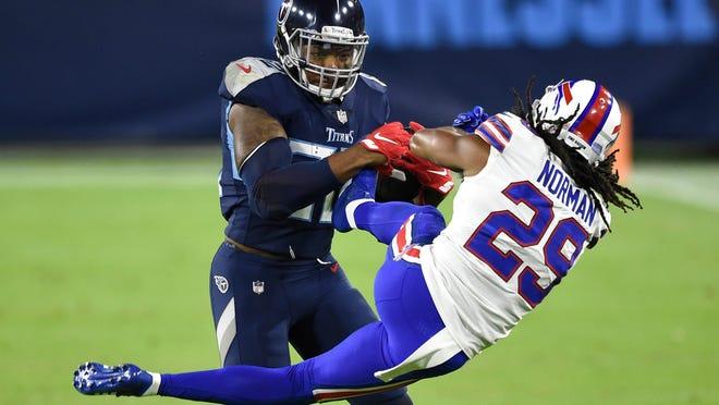 Derrick Henry tosses Josh Norman down during Bills-Titans game