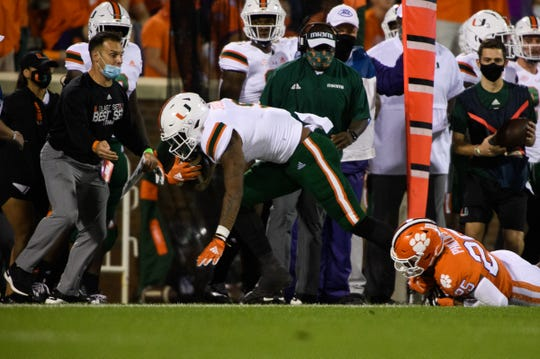 Clemson safety Jalyn Phillips (25) tackles Miami (Fla.)  tight end Brevin Jordan during the first quarter at Memorial Stadium.
