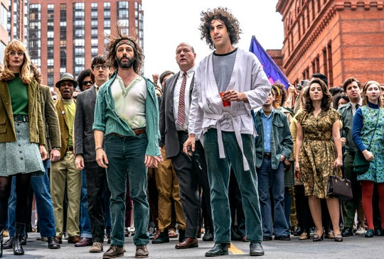 """Jerry Rubin (Jeremy Strong, center left) and Abbie Hoffman (Sacha Baron Cohen) lead a protest in Aaron Sorkin's """"The Trial of the Chicago 7."""""""