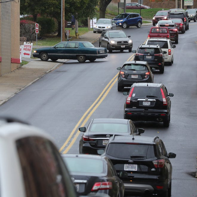 Traffic is backed up along Grant Street as people head to the Summit County Board of Elections in Akron to cast their votes Thursday.