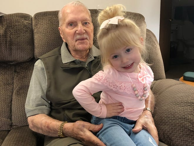 Chuck Wintrow, 87, entertains his granddaughter, Kyia, 3, earlier this year. Wintrow's daughter, Lori Bisesi, is frustrated that the family is not permitted to visit his room at The Gables of Green.