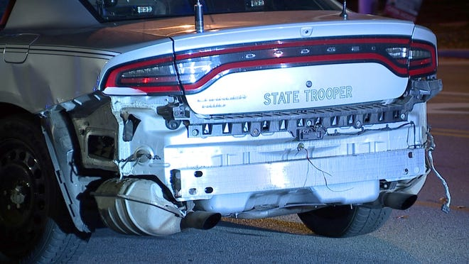 An Ohio State Highway Patrol cruiser reportedly was struck by a driver in a stolen vehicle during a police chase.